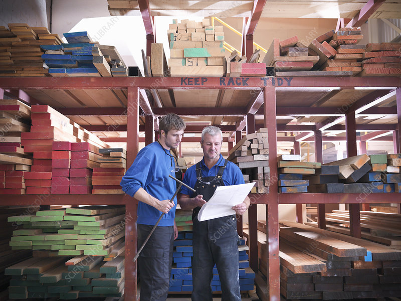 Workers reading together in joinery