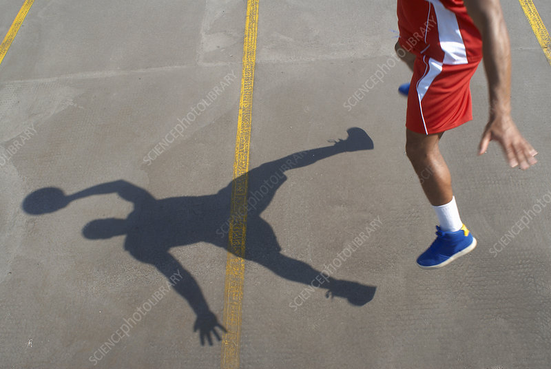 Basketball player jumping with ball