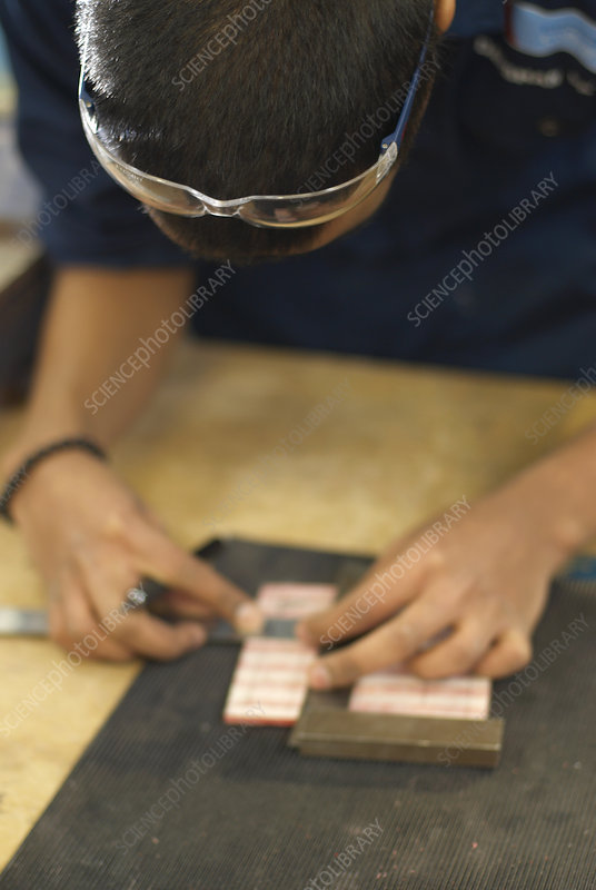Worker measuring pieces of wood