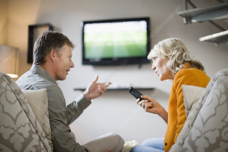 Couple arguing over remote control