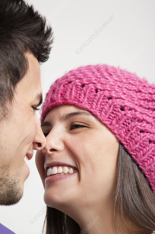 Smiling couple touching noses