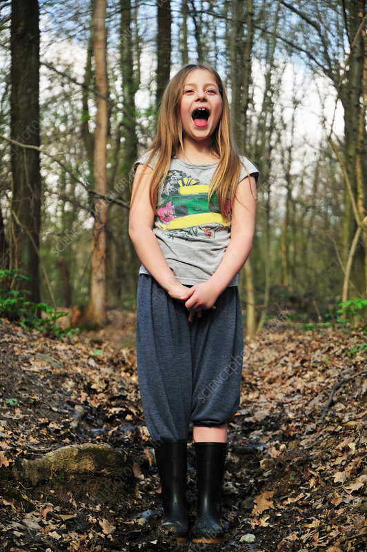 Girl shouting in forest