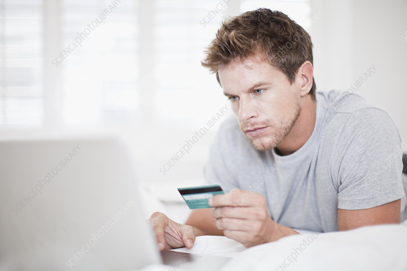 Man shopping online in bed