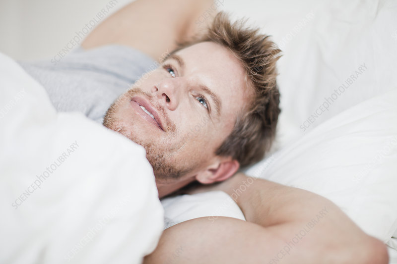 Close up of man relaxing in bed