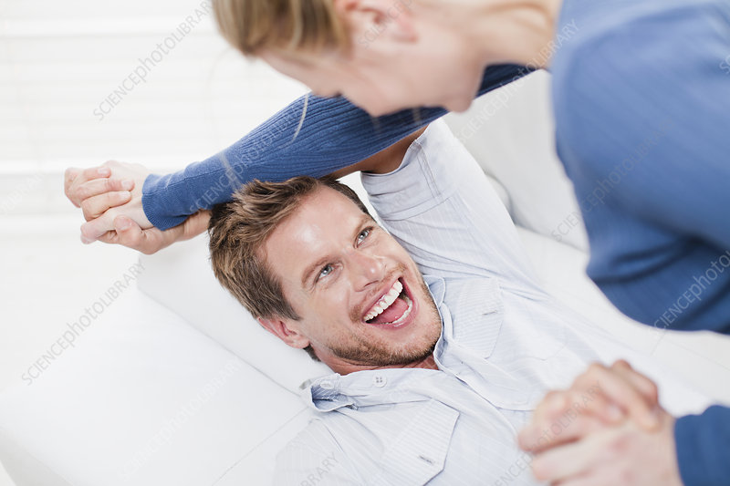 Couple playing together on couch