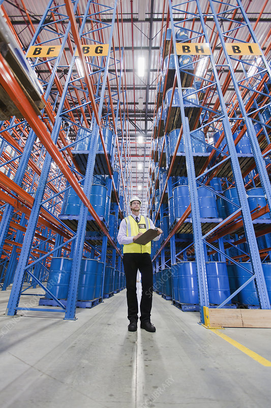 Worker standing in warehouse