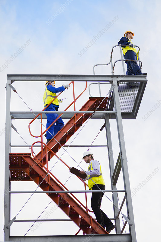 Workers climbing stairs on site