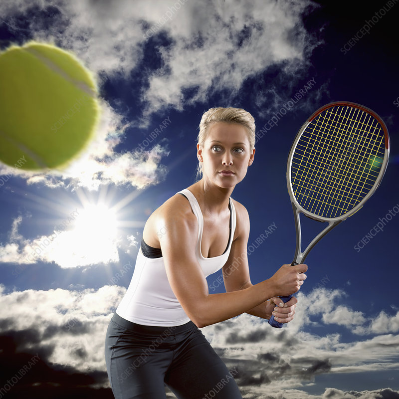 Woman playing tennis against blue sky