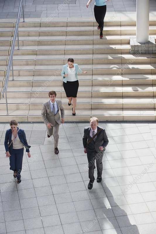 Business people walking in courtyard