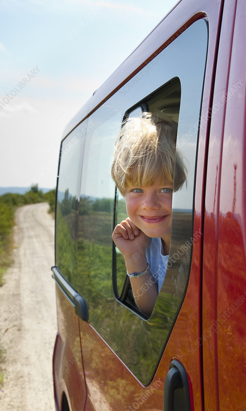 Boy peering out car window