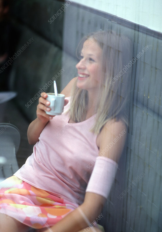 Girl drinking hot chocolate in cafe