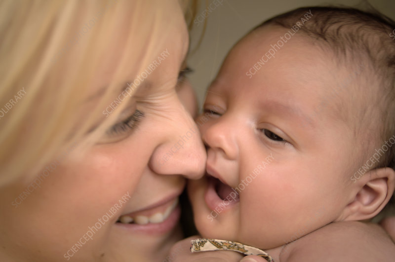 Mother touching noses with infant