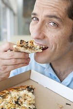Close up of man eating pizza