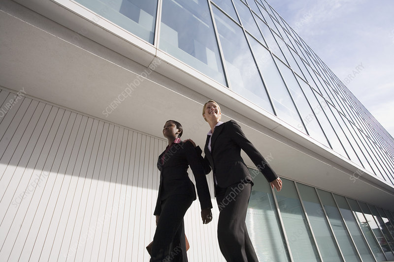 Businesswomen walking outside building