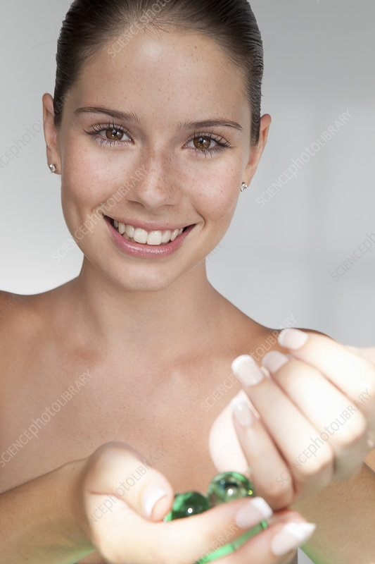 Woman playing with glass beads