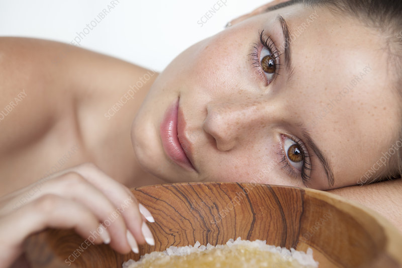 Woman laying by bowl of sugar