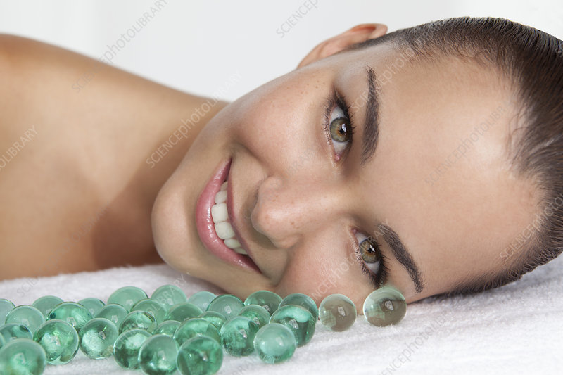 Close up of woman with glass beads
