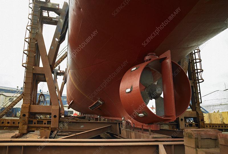 Turbine on underside of ship at dock