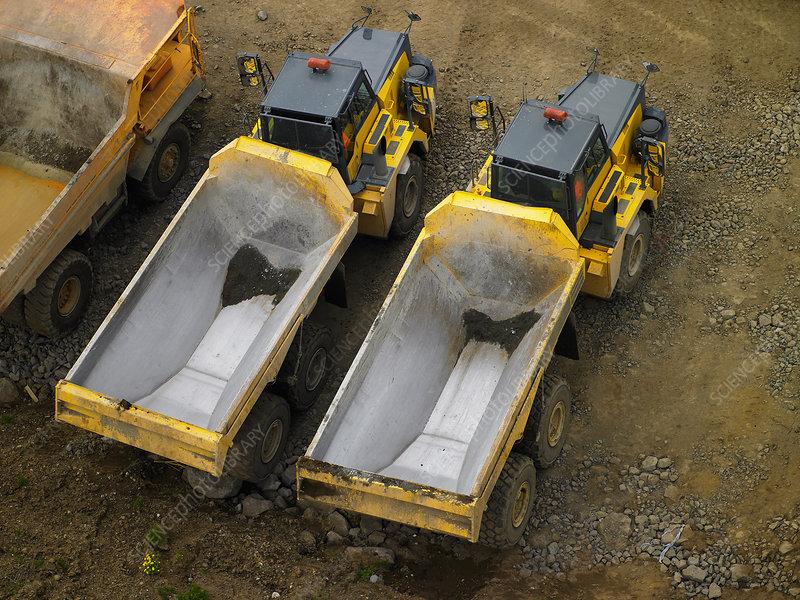 Dump trucks parked in quarry