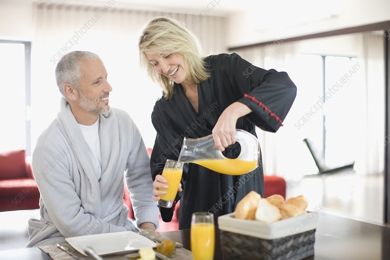 Woman serving breakfast to husband