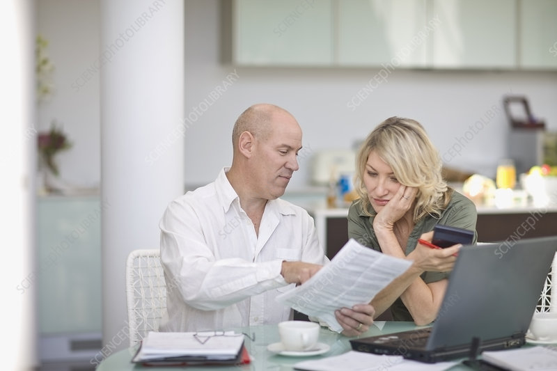 Couple paying their bills at home