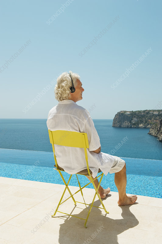 Older man overlooking Dragonera Island