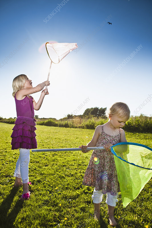 Girls playing with butterfly nets