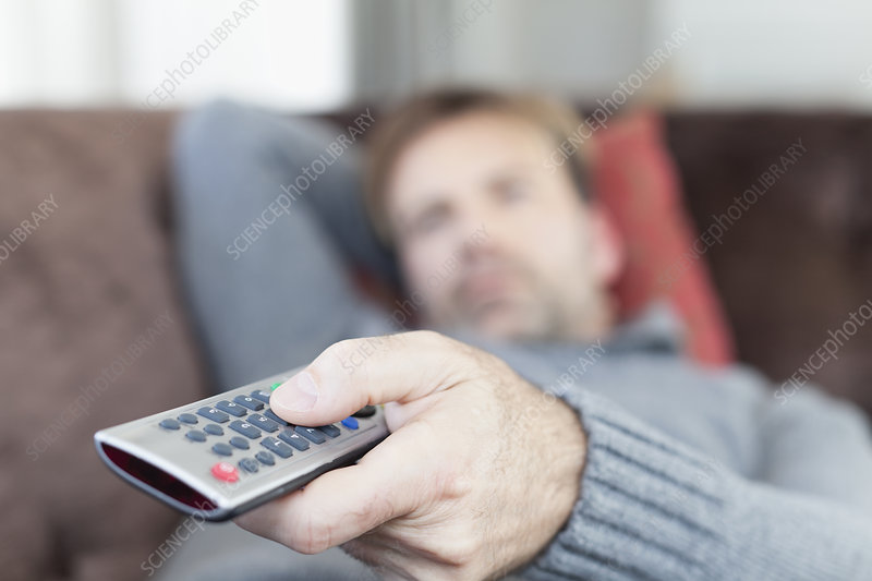 Close up of man using remote control