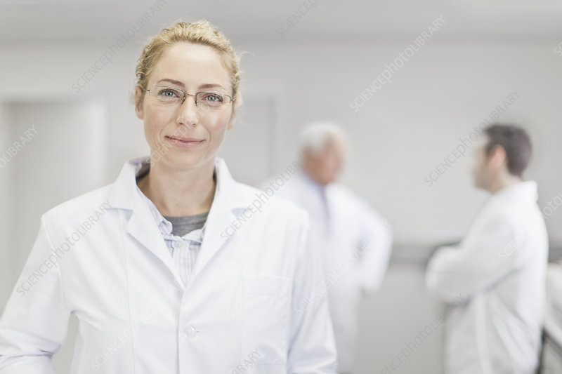 Scientist smiling in pathology lab