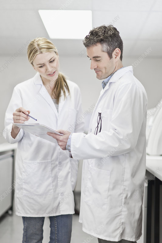Scientists talking in pathology lab