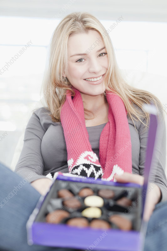 Teenage girl with box of chocolates