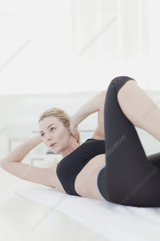 Woman doing crunches at home