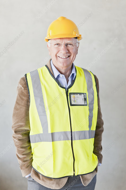 Smiling businessman wearing hard hat