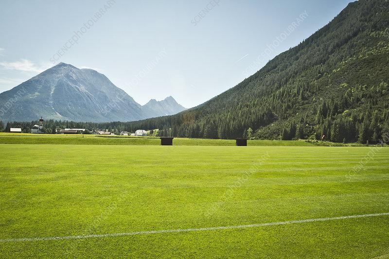 Sports field in rural landscape