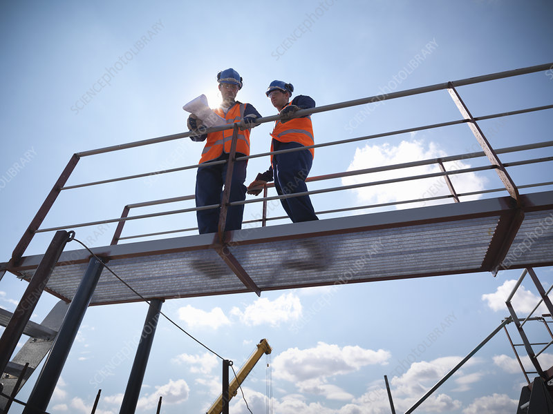 Engineers overlooking ship building