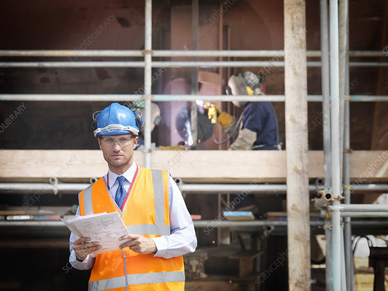 Businessman on shipbuilding site