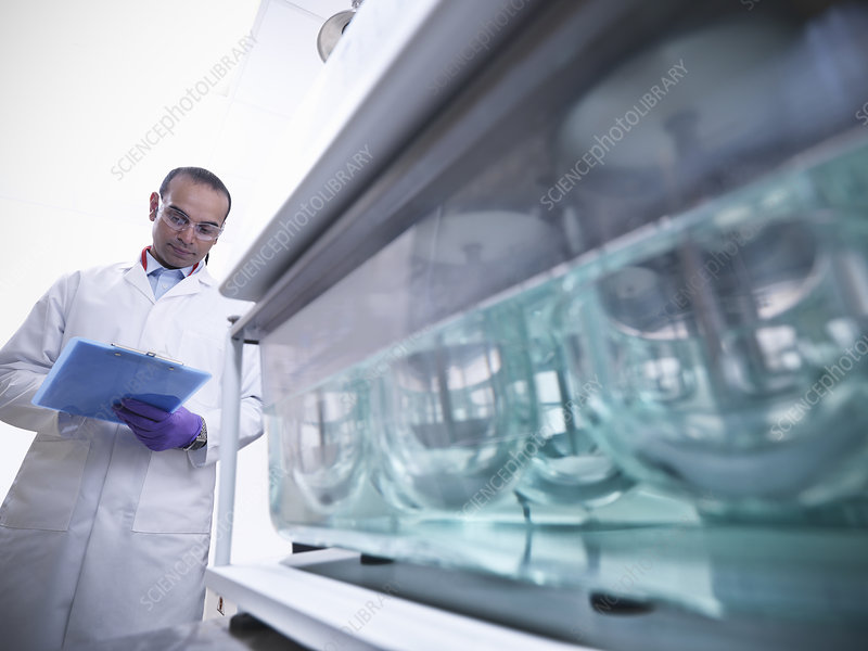 Scientist working on equipment in lab