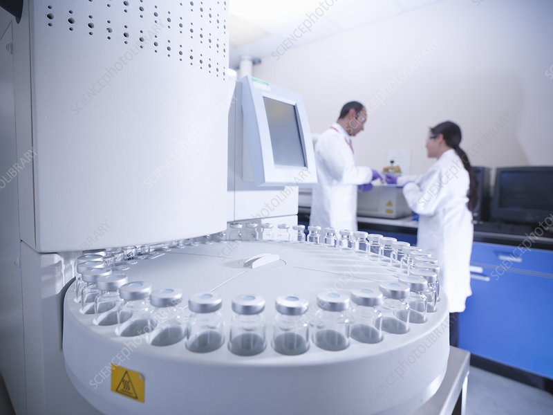 Scientists working on equipment in lab