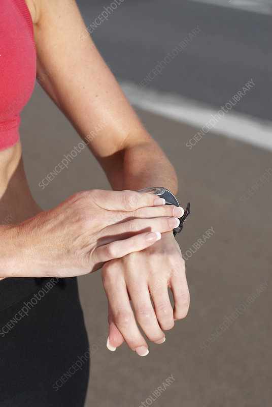 Runner checking her watch