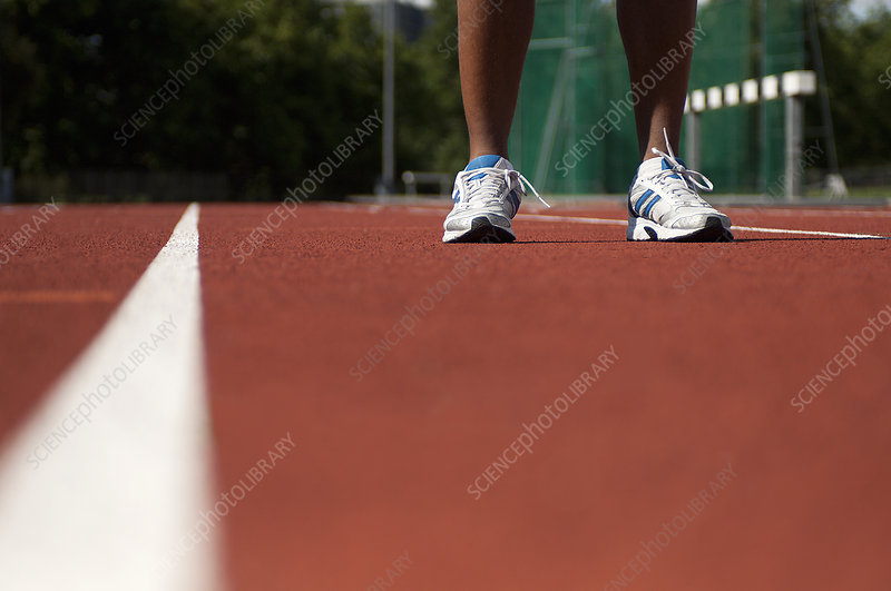 Close up of athlete's feet on track