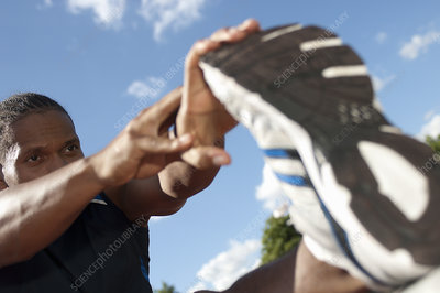 Close up of athlete stretching outdoors