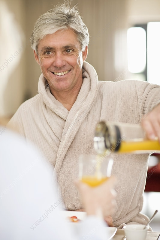 Man having breakfast with wife