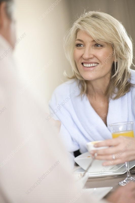 Woman having breakfast with husband