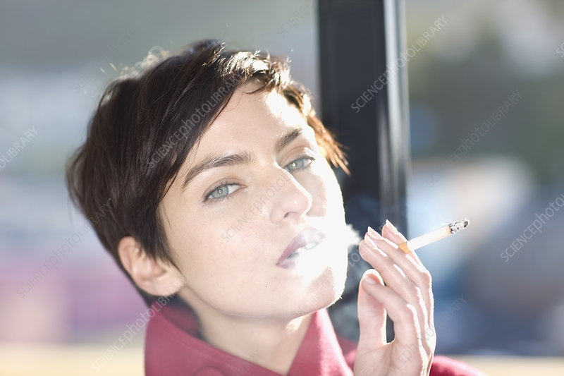 Woman smoking cigarette outdoors
