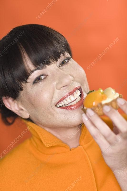 Close up of woman eating snack