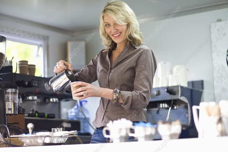 Woman pouring coffee in coffee shop