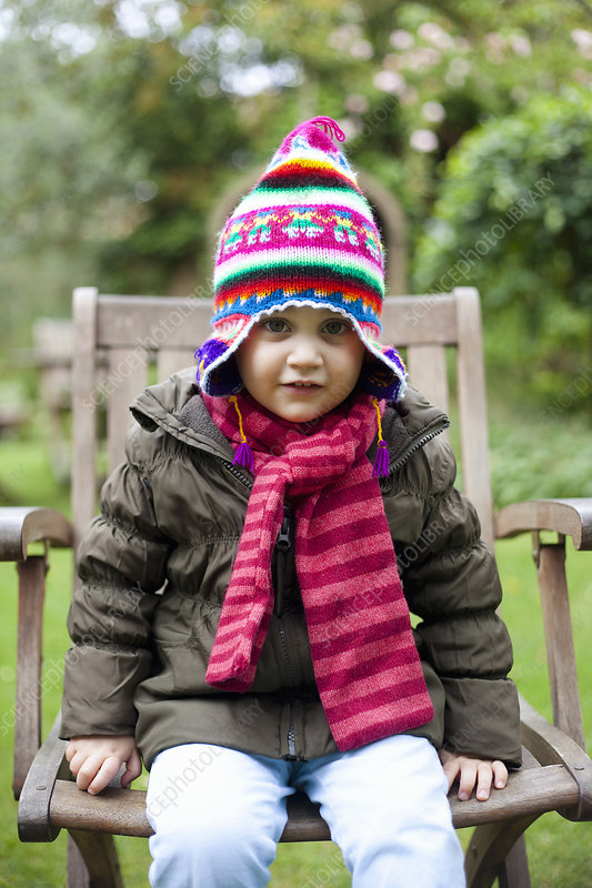 Girl wearing coat, scarf and hat