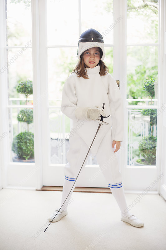 Girl wearing fencing gear in living room