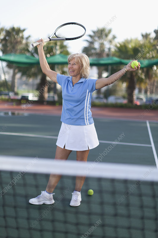 Older woman cheering on tennis court