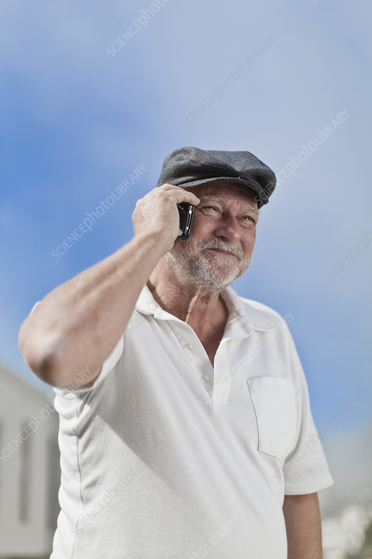 Older man talking on cell phone